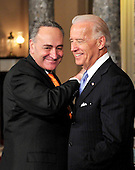 United States Senator Chuck Schumer (Democrat of New York) pats U.S. Vice President Joe Biden on the shoulder as he arrives in the Old Senate Chamber in the U.S. Capitol for the photo-op of the reenactment of his swearing-in  in Washington, D.C. on Wednesday, January 5, 2011.  .Credit: Ron Sachs / CNP.(RESTRICTION: NO New York or New Jersey Newspapers or newspapers within a 75 mile radius of New York City)