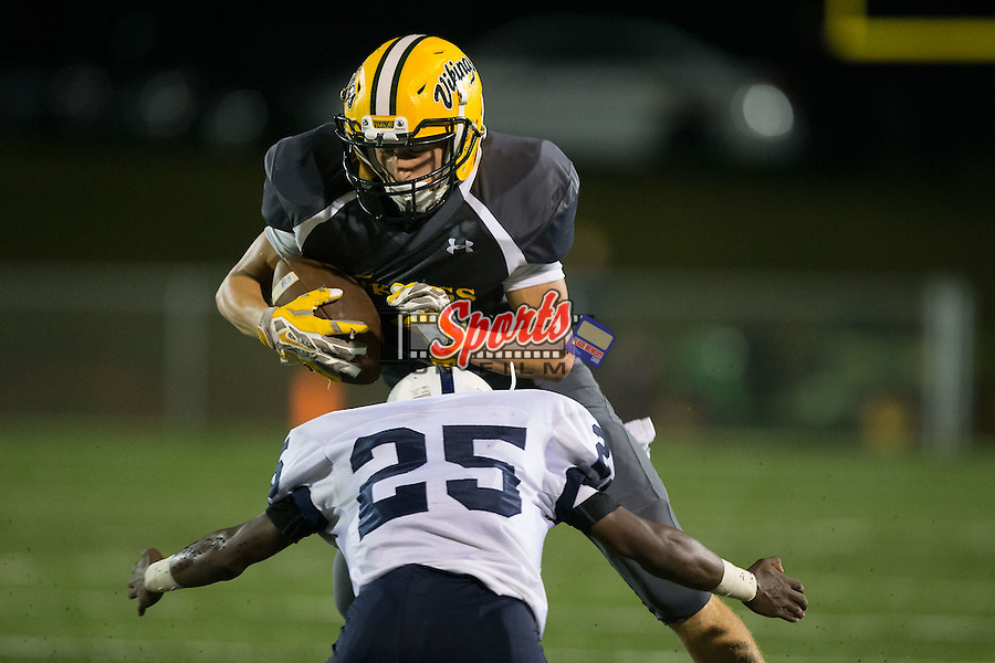 Tristan Ryen (1) of the Central Cabarrus Vikings prepares to absorb a hit from Devonte Gill (25) of the Hickory Ridge Ragin' Bulls at Central Cabarrus High School on September 25, 2015 in Concord, North Carolina.  The Ragin' Bulls defeated the Vikings 41-12.  (Brian Westerholt/Sports On Film)