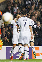 The ball flies past as Erik Lamela (left) of Tottenham Hotspur celebrates his 2nd goal during the UEFA Europa League group match between Tottenham Hotspur and Monaco at White Hart Lane, London, England on 10 December 2015. Photo by Andy Rowland.