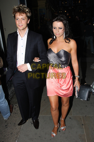 GUEST & KAREN HARDY .Attending the Pixie Lott Party for her new Lipsy clothing line held at Movida, Oxford Circus, London, England, UK,.April 28th 2010.full length strapless coral pink black satin silk ruched dress silver ankle strap sandals  .CAP/MAR.© Martin Harris/Capital Pictures.