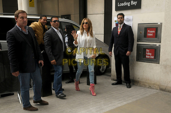 Jennifer Lopez <br /> Arriving at BBC Radio 1, London, England.<br /> 30th May, 2013 <br /> full length white blazer shirt blouse jeans denim pink ankle boots clutch bag sunglasses shades open toe spiked spikes studs studded car van entourage minders bodyguards security<br /> CAP/IA<br /> &copy;Ian Allis/Capital Pictures
