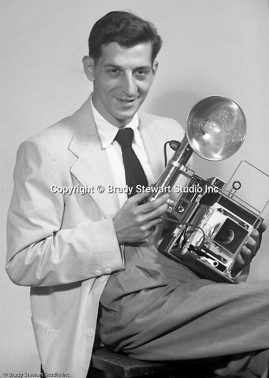 Pittsburgh PA:  Brady Stewart Studio photographer Ross Catanza.  Ross was one of the studio's great photographers.  Ross in responsible for a great deal of the location photographer from 1950 through 1965.  He is also responsible for much of the Pittsburgh Skyline photographs taken from 1950 through 1965.  After leaving Brady Stewart Studio in 1965, he became an award-winning photographer with the Pittsburgh Post Gazette - 1952.