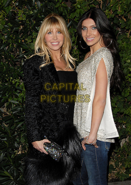 LISA GASTINEAU & BRITTNY GASTINEAU.Attends The Drinks America Launch Party for Trump Vodka held at Les Deux in Hollywood, California, USA. .January 17th, 2007.half length one shoulder top silver sequins black fur velvet coat clutch purse diamante .CAP/DVS.©Debbie VanStory/Capital Pictures