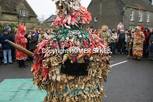 Marshfield Mummers, Boxing Day performance, Gloucestershire, England. 2006.  Little Jolly Jack with his family on his back.