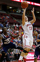 Ohio State Buckeyes guard Cait Craft (13) makes a basket as Florida Atlantic Owls guard Latavia Dempsey (14) and Florida Atlantic Owls guard Shaneese Bailey (2) look on in the second half of the college basketball game between the Ohio State Buckeyes and the Florida Atlantic Owls at Value City Arena in Columbus,  Sunday afternoon, November 10, 2013. The Ohio State Buckeyes narrowly defeated the Florida Atlantic Owls 91 - 88. (The Columbus Dispatch / Eamon Queeney)