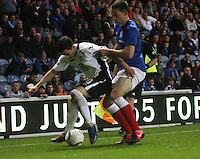 Nicky Clark closed down by Lee Wallace in the Rangers v Queen of the South Quarter Final match in the Ramsdens Cup played at Ibrox Stadium, Glasgow on 18.9.12.