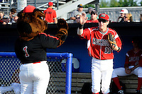 Batavia Muckdogs outfielder Ryan Aper #11 high fives mascot Homer during introductions before a game against the Mahoning Valley Scrappers on June 21, 2013 at Dwyer Stadium in Batavia, New York.  Batavia defeated Mahoning Valley 3-2.  (Mike Janes/Four Seam Images)