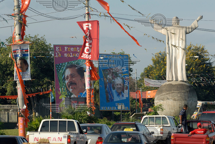 Traffic passes a statue of Jesus Christ and an election billboard urging voters to back ex-president Daniel Ortega of the Sandinista Front (FSLN) in the upcoming presidential elections.Photo: Dermot Tatlow/Panos Pictures/Felix Features