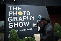 NEW YORK, NY - MARCH 30: A man takes pictures as people attend the 37th edition of The Photography Show, presented by AIPAD on March 30, 2017 in Manhattan, New York. One of the world's most prestigious annual photography events, The Photography Show is the longest-running and foremost exhibition dedicated to the photographic medium, offering a wide range of museum-quality work, including contemporary, modern, and 19th-century photographs as well as photo-based art, video, and new media. Photo by VIEWpress/Eduardo MunozAlvarez