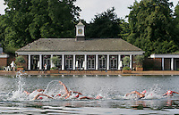22 JUL 2007 - LONDON, UK - Competitors swim past the Lido on the Serpentine - Corus Elite Triathlon Series. (PHOTO (C) NIGEL FARROW)
