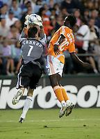 Joe Cannon (7) saves the ball against Dynamo's Kei Kamara (10).San Jose Earthquakes tied Houston Dynamo 1-1 at Buck Shaw Stadium in Santa Clara, California. September 13, 2008.