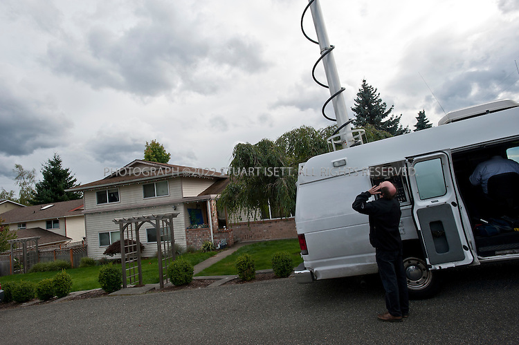 10/4/2011--Seattle, WA, USA..Journalists from around the world gather outside Amanda Knox's home  in West Seattle Oct. 4th 2011. Amanda Knox is expected back in Seattle at 5pm on British AIrways flight after being acquitted of murder in an Italian court on Monday...©2011 Stuart Isett. All rights reserved.