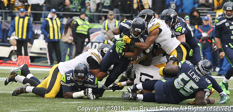 Seattle Seahawks running back Thomas Rawls is stopped short of the goal line by Pittsburgh Steelers defenders at CenturyLink Field in Seattle, Washington on November 29, 2015.  The Seahawks beat the Steelers 39-30.      ©2015. Jim Bryant Photo. All Rights Reserved.
