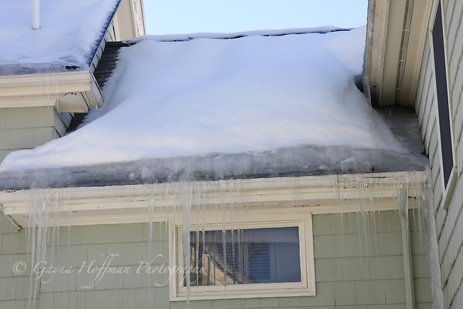 Ice dam on roofline of house.
