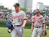 Washington Nationals pitcher Steven Strasburg (37) and catcher Wilson Ramos (40) walk to the dugout following warm-ups prior to the game against the Chicago Cubs at Wrigley Field in Chicago on Thursday, August 22, 2013.  The Nationals won the game 5 - 4 in thirteen innings.<br /> Credit: Ron Sachs / CNP