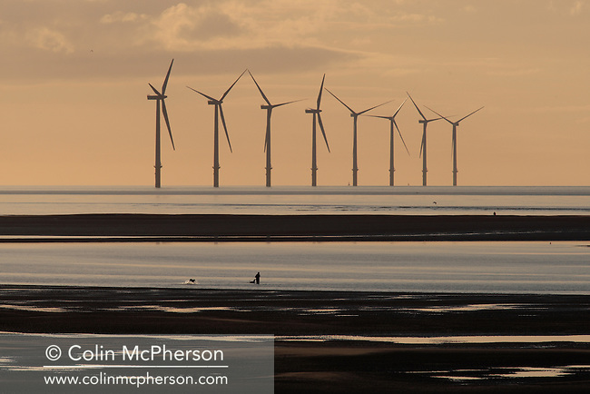 Turbines in Liverpool Bay, part of the Burbo Offshore Wind Farm being built off the coast of North Wirral. Construction began in 2006 with the installation of the foundations. The wind turbines will be generating electricity by the end of 2007. Burbo Offshore will consist of 25 turbines, each capable of producing 3.6 MW of electricity generating up to 90MW of clean, renewable energy for the next 25 years - enough electricity for over 75,000 homes or 12% of all the houses in Merseyside.