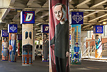 "Brother Mark Elder, C.M., an adjunct faculty member in DePaul's art, media and design program, and his students have been working to install murals under the Fullerton ""L"" Station in Lincoln Park that highlight DePaul University's history in Chicago. <br /> <br /> Elder's artistic retrospective, titled ""The Story of 'The Little School Under the 'L'', will eventually feature 25 murals permanently installed on the massive concrete pillars that support the ""L"" station nearest the university's Lincoln Park Campus. (DePaul University/Jamie Moncrief)"