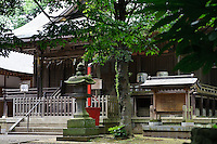 A Shinto shrine behind Terada Honke sake brewery, Kozaki, Chiba Prefecture, Japan, June 15, 2009. Terada Honke sake brewery has been brewing sake in the town of Ozaki since 1673. They make sake using organic rice, natural sake yeast, and traditional sake brewing methods.