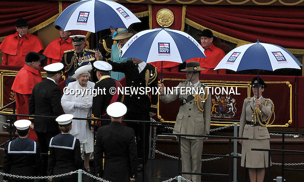 """THE QUEEN and DUKE OF EDINBURGH.Her Majesty The Queen and His Royal Highness The Duke of Edinburgh were onboard the Royal Barge..London. 03/06/2012.Mandatory Credit Photo: ©B Sutton/NEWSPIX INTERNATIONAL..**ALL FEES PAYABLE TO: """"NEWSPIX INTERNATIONAL""""**..IMMEDIATE CONFIRMATION OF USAGE REQUIRED:.Newspix International, 31 Chinnery Hill, Bishop's Stortford, ENGLAND CM23 3PS.Tel:+441279 324672  ; Fax: +441279656877.Mobile:  07775681153.e-mail: info@newspixinternational.co.uk"""