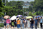 August 8, 2019, Tokyo, Japan - Tourists put up their sunshades under sweltering heat - over 35 Celsius - near the Imperial Castle in the heart of Tokyo on Thursday, August 8, 2019. Temperatures have been stuck above 31 Celsius in and around Tokyo for two weeks now. (Photo by Natsuki Sakai/AFLO) AYF -mis-