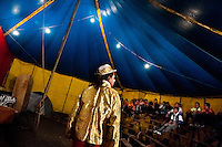 Walter, a Colombian clown, performs in front of an audience at the Circo Anny, a family run circus wandering the Amazon region of Ecuador, 4 July 2010. The Circo Anny circus belongs to the old-fashioned traveling circuses with a usual mixture of acrobat, clown and comic acts. Due to the general loss of popularity caused by modern forms of entertainment such as movies, TV shows or internet, these small family enterprises balance on the edge of survival. Circuses were pushed away and now they have to set up their shows in more remote villages. The circus art and culture is slowly dying.