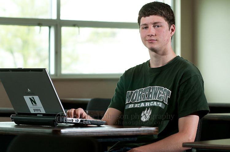 11 May 2009 -- Northwest Missouri State University Electronic Textbooks -- Northwest Missouri State University business management major Kevin Green, 20, looks at a university laptop, similar to the one he used last semester, in a classroom of Colden Hall. NMSU in Maryville, Mo. has started to a pilot program to use electronic textbooks or etextbooks instead of paper printed books in classes on campus. PHOTO/Daniel Johnson (Copyright 2009 Daniel Johnson)
