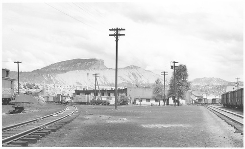 A wide-angle northwest facing view from the D&amp;RGW yards showing the Durango roundhouse and RGS Goose #2 and #6 with a drag flanger.  Also a partial view of RGS caboose #0409.<br /> RGS  Durango, CO  Taken by Richardson, Robert W. - 7/5/1941