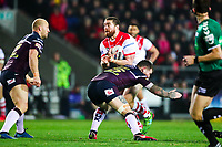 Picture by Alex Whitehead/SWpix.com - 16/03/2018 - Rugby League - Betfred Super League - St Helens v Leeds Rhinos - Totally Wicked Stadium, St Helens, England - St Helens' Kyle Amor is tackled by Leeds' Brett Delaney.