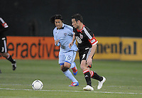 D.C. United forward Hamid Salihi (9) shields the ball Sporting Kansas City midfielder Roger Espinoza (15) Sporting Kansas City defeated D.C. United  1-0 at RFK Stadium, Saturday March 10, 2012
