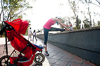 Elena Paña a mother who runs and exercises with her daughter in a stroller. Chapultepec park, Mexico City, Mexico.