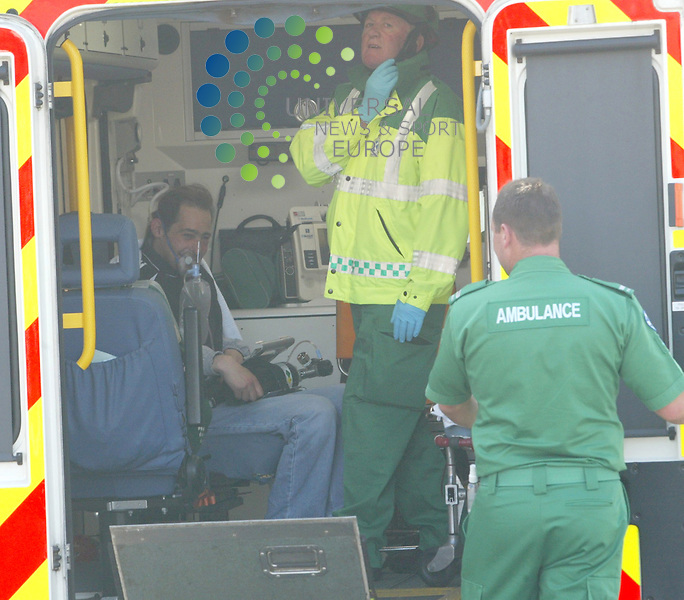 Mr. Darren McTaggart getting into the Ambulance for some medical help after suffering smoke inhalation after the house explosion at 57 Walker Av Barassie Troon