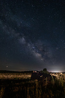 The Milky way over an old steam tractor along the Cimarron River in Cimarron National Grassland Western Kansas.