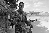 - Mozambique,  guerrilla of RENAMO anti-government organization in the village of Inhaminga, province of Sofala.....- Mozambico, guerrigliero della organizzazione antigovernativa RENAMO nel villaggio di Inhaminga, provincia di Sofala - Mozambique 1993, village occupied by anti-government rebels of RENAMO in the province of Sofala<br /> <br /> - Mozambico 1993, villaggio occupato da ribelli antigovernativi della RENAMO in provincia di Sofala