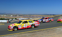 Jun. 21, 2009; Sonoma, CA, USA; NASCAR Sprint Cup Series driver Marcos Ambrose (47) leads Max Papis (13) during the SaveMart 350 at Infineon Raceway. Mandatory Credit: Mark J. Rebilas-