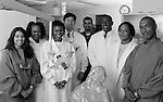 b/w image, group portrait of multi-ethnic doctors, dentists standing in examination room, group practice
