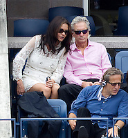 CATHEREINE  ZETA JONES & MICHAEL DOUGLAS watch NOVAK DJOKOVIC (SRB) (1) against ROGER FEDERER (SUI) (1) in the Semi-Finals of the Men's SIngles. Novak Djokovic beat Roger Federer 6-7 4-6 6-3 6-2 7-5..Tennis - Grand Slam - US Open - Flushing Meadows - New York - Day 13 - September 10th  2011..© AMN Images, Barry House, 20-22 Worple Road, London, SW19 4DH, UK..+44 208 947 0100.www.amnimages.photoshelter.com.www.advantagemedianetwork.com.