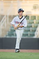 McKay Rowand, son of Chicago White Sox minor league outfield and base running instructor Aaron Rowand, performs his duties as bat boy during the South Atlantic League game between the Greensboro Grasshoppers and the Kannapolis Intimidators at Intimidators Stadium on July 17, 2016 in Greensboro, North Carolina.  The Grasshoppers defeated the Intimidators 5-4 in game two of a double-header.  (Brian Westerholt/Four Seam Images)