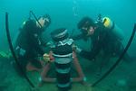 Craig Humphrey and Katharina Fabricius install environmental recording device in a reef near Dunk Island