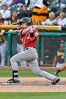 Dustin Garneau (13) of the Albuquerque Isotopes follows through on his swing against the Salt Lake Bees during the Pacific Coast League game at Smith's Ballpark on August 30, 2016 in Salt Lake City, Utah. The Bees defeated the Isotopes 3-2. (Stephen Smith/Four Seam Images)