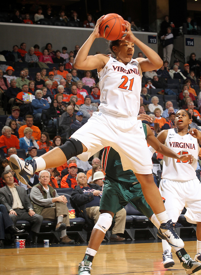 Jan. 6, 2011; Charlottesville, VA, USA; Virginia Cavaliers forward Jazmin Pitts (21) grabs a rebound during the game against the Miami Hurricanes at the John Paul Jones Arena.  Mandatory Credit: Andrew Shurtleff-