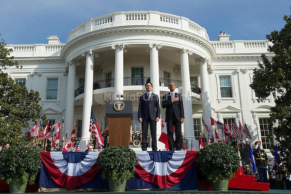 United States President Barack Obama (R) and Canadian Prime Justin Trudeau stand for their national anthems during an arrival ceremony on the South Lawn of the White House, in  Washington, D.C. on March 10, 2016. <br /> Credit: Kevin Dietsch / Pool via CNP/MediaPunch