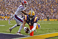 Ja'Marr Chase #1 of the LSU Tigers dives for a touchdown as Zach Hannibal #18 of the Louisiana Tech Bulldogs defend during the first half at Tiger Stadium on September 22, 2018 in Baton Rouge, Louisiana. Chase was later ruled out of bound before crossing the goal line.