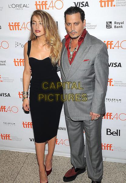 14 September 2015 - Toronto, Ontario, Canada - Amber Heard, Johnny Depp. &quot;Black Mass&quot; Premiere during the 2015 Toronto International Film Festival held at The Elgin Theatre. <br /> CAP/ADM/BPC<br /> &copy;Brent Perniac/AdMedia/Capital Pictures
