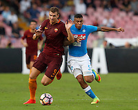 Calcio, Serie A: Napoli vs Roma. Napoli, stadio San Paolo, 15 ottobre. <br /> Roma&rsquo;s Edin Dzeko, left, is challenged by Napoli&rsquo;s Allan during the Italian Serie A football match between Napoli and Roma at Naples' San Paolo stadium, 15 October 2016. Roma won 3-1.<br /> UPDATE IMAGES PRESS/Isabella Bonotto