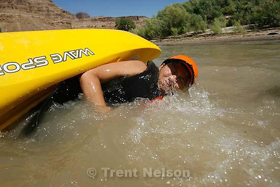 Kayaking at butler wash. roxana Orellana with guide Craig Waddell (black helmet and dog)