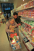 An old couple browses tooth paste at a supermarket in Guangzhou, China.