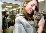 SOUTHBURY, CT- 30 NOVEMBER 2006-113006JS01-Nicole Hubbard of Woodbury, holds  a grey tabby kitten she adopted from the North Shore Animal League mobile adoption center Thursday at the Southbury Green shopping plaza. The North Shore Animal League holds adoption centers throughout the area including the one in Southbury that is held on the last Thursday of the month. For more information, including a mobile adoption schedule, contact Sue Mills, the Connecticut Outreach Coordinator at (203) 740-0647 or on the web at www.nsalamerica.org. <br /> Jim Shannon/Republican-American