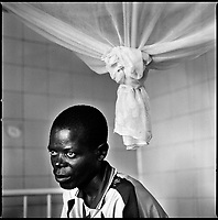 Huambo, Angola, May, 24, 2006.Pera, 30. More than 300 TB patients live in Huambo State Sanatorium, hundreds more are outside patients. TB is endemic in the region, fueled by poverty, malnutrition, inadequate hygiene and the rapid spreading of HIV/AIDS since the end of the civil war in 2002.