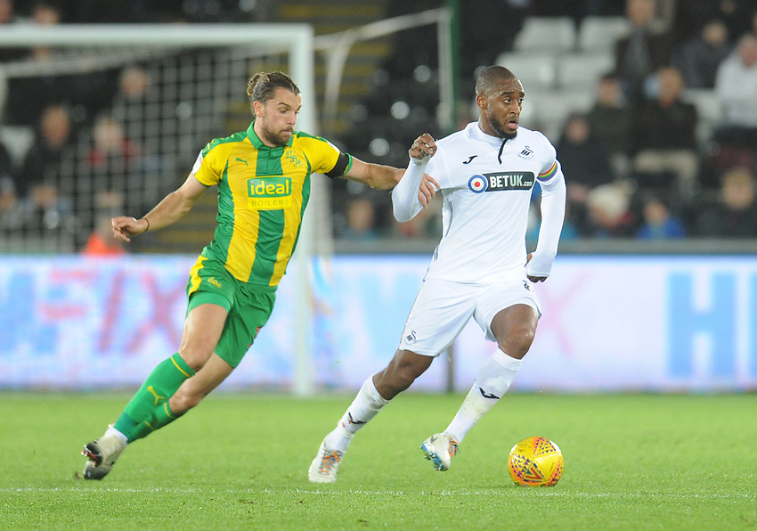 Swansea City's Leroy Fer under pressure from West Bromwich Albion's Jay Rodriguez<br /> <br /> Photographer Kevin Barnes/CameraSport<br /> <br /> The EFL Sky Bet Championship - Swansea City v West Bromwich Albion - Wednesday 28th November 2018 - Liberty Stadium - Swansea<br /> <br /> World Copyright © 2018 CameraSport. All rights reserved. 43 Linden Ave. Countesthorpe. Leicester. England. LE8 5PG - Tel: +44 (0) 116 277 4147 - admin@camerasport.com - www.camerasport.com