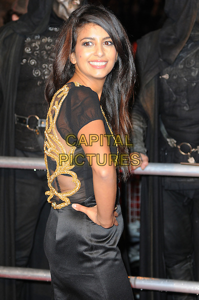 "KONNIE HUQ .""Harry Potter And The Deathly Hallows: Part 1"" World Film Premiere, Empire cinema Leicester Square and Odeon Leicester Square, London, England, UK, 11th November 2010. .half length black dress hand on hip gold pattern side smiling mesh see thru through .CAP/CAS.©Bob Cass/Capital Pictures."
